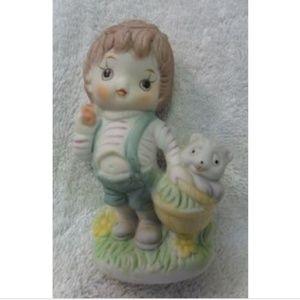 Fine Porcelain Boy Figurine carrying Basket & Bear